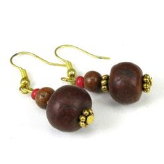 * * Dangle earrings featuring the spiritual bodhi seed and rosewood bead  * The bodhi seeds are about 12mm and the rosewood bead are abut 5-6mm * Rosewood is also known as red sandalwood, but beads do