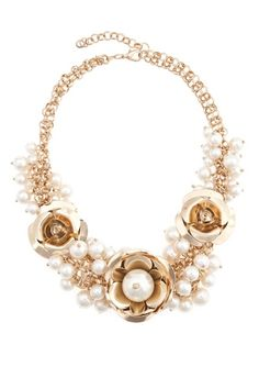 Gleaming gilded petals and clustered pearl beads will transform you into garden party royalty!