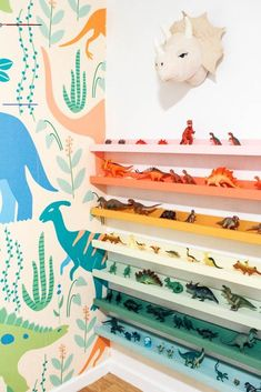 DIY Dinosaur Shelf - at home with Ashley - #kidsroom - diy dinosaur shelf. Do you have a kid's room and need some toy storage ideas? I made rainbow dino ledges for my boy's bedroom. Childen's books...