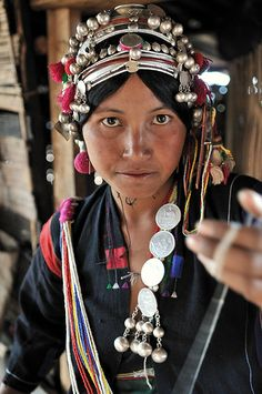 Laod | Akha woman wearing her traditional headdress. Louang Namtha Province. | ©FO Travel