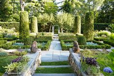 The esteemed designer brings her impeccable sense of style to the grounds of her Connecticut home. Click through for more gorgeous garden photos and gardening decor ideas.