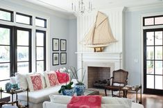 """Boasting just a whisper of blue, this wall color (Benjamin Moore's Glass Slipper) feels like the perfect fit for this coastal home — but avoids the blue and white beach cliché. """"This Old New House"""" - tropical - living room - miami - Mackle Construction Coastal Living Room, Room Design, Interior Design, Luxury Interior Design, Home, Beachy Living Room, Tropical Living Room, Living Room Designs, Room"""