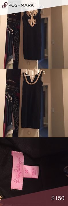 Lily Pulitzer Dress Black with champagne details on the top of the front of the dress and the back. It is a double zero, and is super comfy. Very formal, has only been worn twice. It is in very very good condition. Lilly Pulitzer Dresses Midi