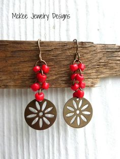 Chocolate patina metal flowers, red glass beads simple earrings. McKee Jewelry Designs