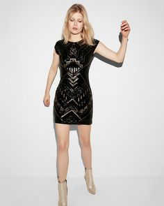 The flattering, Art Deco-inspired shapes and angles of this sequined, velvet mini dress dazzle at any occasion. You'll love the feel of the silky lining and the way the stretch fabric lets you move easily from one party to the next.