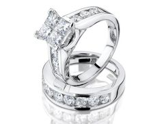 Four invisible-set square princess cut diamonds are flanked by rows of gently glimmering round accent diamonds in this gorgeous engagement ring and wedding band set, crafted in 10 karat white gold. The pair is completed by a matching semi-eternity diamond wedding band, making the total carat weight