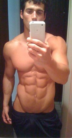Beautiful, ripped young hunk does a mirror selfie