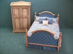 French Antiqued Cream Bed Dressed in Blue and White with Matching Armoire. $69.95, via Etsy.