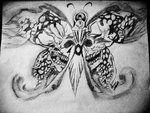 Best Geometric Tattoo - Skull Buddha Butterfly Tattoo Check more at http://tattooviral.com/tattoo-designs/geometric-designs/geometric-tattoo-skull-buddha-butterfly-tattoo/