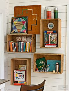 Vintage crates become book shelves and game storage.