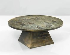 """PHILIP AND KELVIN LAVERNE A RARE """"PHARAOH"""" COFFEE TABLE etched Philip and Kelvin LaVerne acid-etched and enameled brass over wood 18 1/8  in. (46 cm) high 44 in. (111.7 cm) diameter circa 1965"""