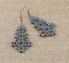Earrings handmade of beautiful Japanese TOHO seed beads and Czech glass beads in green, purple and blue.    Length from top of the ear wire: 6cm