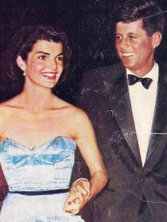 They are holding hands! Jack and Jackie Kennedy