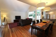 Spotted gum wood floors, 55cm drum lights over dining table. Walls Ecru a half Strength and trim Antique White USA