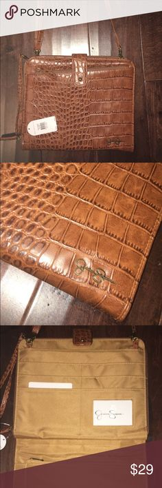Jessica Simpson Faux Alligator Cross-body Have a brand new Jessica Simpson tan brown cross body! Opens up to a multi card holder and flat pocket. With additional zipper outside opens up to another pocket. Use it for business with the removable strap and wristlet, turning it into a oversized wallet. Never used, perfect condition, with tags. Jessica Simpson Bags Crossbody Bags