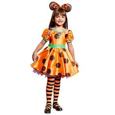 Life is a mousequerade in Minnie's brilliant orange satin dress with glittering polka dots, puffed sleeves and ruffled tulle, a tempting treat for your Halloween sweetheart! Includes matched stripe leggings to complete the spell!