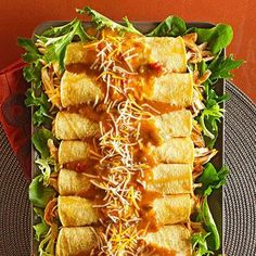 These Easy Chicken Enchiladas are made in your slow cooker!  #simple #delish #sundaylunch