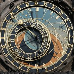 Prague Astronomical clock. Built in 1410, the apparatus is the world's oldest functioning astronomical clock. It adorns the facade of the Old Town Hall of Prague's Old Town Square. The clock's astronomical dial tracks the motion of the sun, moon and stars. Above the dial, statues of the 12 apostles appear at every hour from 9 a.m. to 9 p.m.