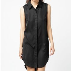Flattering Public School sleeveless shirt dress Sophisticated black silk sleeveless shirt dress. Straight relaxed fit and side slit vents. Tailored from 100% soft lightweight silk. Dress has a pointed shirt collar, layered armholes and logo-embossed mother-of-pearl buttons hidden under a tonal placket. Public School Dresses