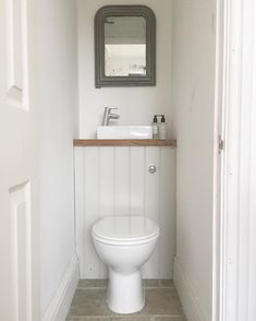 Some bathroom fixtures are made specifically with cloakrooms and small bathrooms in mind. Opt for a small cloakroom counter top basin and place just above your toilet's concealed cistern to make the most of your space. Small Downstairs Toilet, Small Toilet Room, Downstairs Cloakroom, Cloakroom Toilet Small, Cloakroom Sink, Small Toilet Design, Bathroom Under Stairs, Under Stairs Cupboard, Toilet Under Stairs