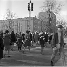 """Ball State University students crossing Riverside Ave. and McKinley Ave. intersection"" - To learn more, visit the Ball State University Campus Photographs in the Ball State University Digital Media Repository. Copyright 2014, Ball State University. All rights reserved."