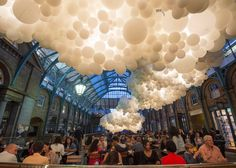 Charles Pétillon fills Covent Garden market with 100,000 white balloons