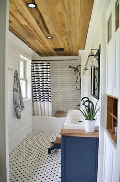 Shiplap walls, cedar ceiling, subway tile, DIY vanity, and vintage flare!  What's not to LOVE!