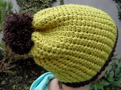 This beautiful beanie hat is hand crocheted with a warm mustard colour super soft yarn. The hat features a brown border and a matching pom pom. The beanie can be worn in a slouchy fashion. It is made using a special stitch which give a very soft texture. The perfect Autumn/Winter fashion accessory! Autumn Winter Fashion, Fall Winter, Hand Crochet, Beanie Hats, Mustard, Knitted Hats, Winter Hats, Warm, Colour
