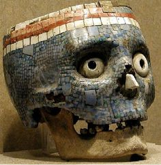 Antique Aztec skull, covered in Turquoise and Coral.