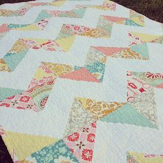 Chevron Quilt. 10in square, sew 1/4in around all edges. cut into quarters on the diagonal.  Sew in rows 1 row with whites together another row with colors together.  Simple:)