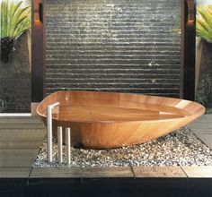 This leaf shaped tub is by Bagno Sasso
