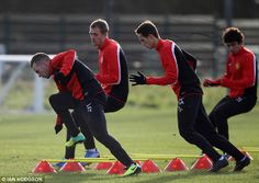 Warming up: (From left to right) Tom Cleverley, Darren Fletcher, Adnan Januzaj and Fabio prepare for the main session