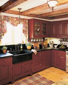Rustic Kitchen - I'm obsessing over red cabinets distressed with black accents.