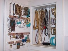 34 Ideas How To Store Your Jewelry - I like this one, built in . . . could put a picture on the door :)