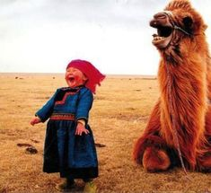 Mongolian girl laughing with a Bactrian camel.  Haven't really been able to find the source, as the cite from the site doesn't pan out.