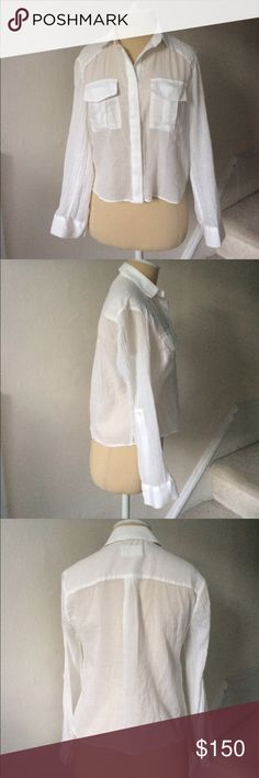 Alice + Olivia White Crop Button Down Blouse EUC Semi sheer white cropped hidden button down from Alice and Olivia. Two button cuff closure. Cuffs can be rolled up to a button halfway up the sleeve. Excellent used condition. A09 * Alice & Olivia Tops Button Down Shirts