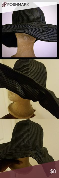 Floppy Hat Very cute and fun hat. Can be worn a number of ways.   I bought it to wear on a cruise so it's only been used once. Great for the park, beach or anywhere you need to keep the sun out of your face. Ashley Stewart Accessories Hats