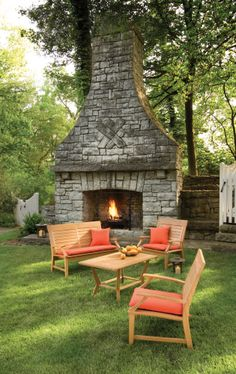 Fantastic yard! Love the fireplace and that teak furniture set... I'll take it all!