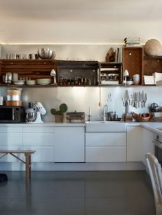 White kitchen with open shelves made from crates.