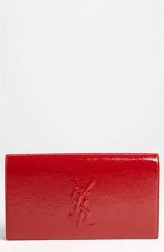 I'm not a fan of logo's, but I do love red and I do love this.  Saint Laurent 'Belle de Jour' Patent Leather Clutch available at #Nordstrom