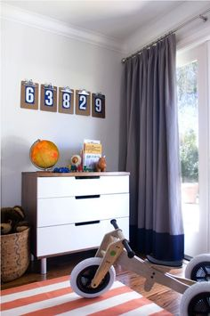 Jute interior Design: Adorable boy's room with light blue walls, white & orange striped rug, modern chest and ...