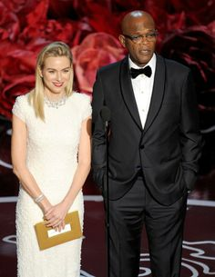HOLLYWOOD, CA - MARCH Actors Naomi Watts and Samuel L. Jackson speak onstage during the Oscars at the Dolby Theatre on March 2014 in Hollywood, California. (Photo by Kevin Winter/Getty Images) In Hollywood, Hollywood California, Samuel Jackson, Oscars 2014, Naomi Watts, Academy Awards, Best Actress, Costume Design, Movie Tv