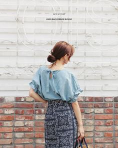 Váy áo bây giờ mốt là phải mịn ở đằng trước, đằng sau đan dây buộc nơ tung xòe - Ảnh 1.