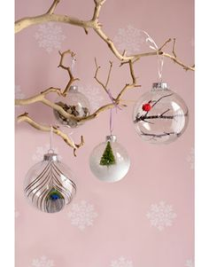 twigs, feather, small tree with snow in glass ornaments
