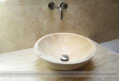 Travertine basin with travertine vanity unit worktop in wet room bathroom