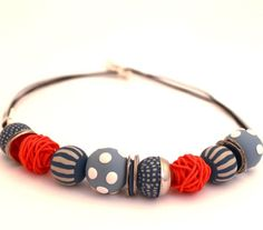 hand made round colorful beads Statement necklace in blue jeans ,tangerine orange and white. $45,00, via Etsy.
