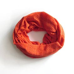 This orange infinity scarf is the perfect go-to accessory. It is soft and comfortable to wear. You can wrap it around your neck twice or wear it in a single loop. This scarf makes a great birthday or Christmas gift.