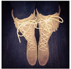 Brown leather moccasin knee high boots with fringe on the top. Very comfortable! Only worn once.