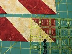 I'm sure I've learned a half dozen ways of making half square triangle units, but my favorite method is taking a square of background fabric...