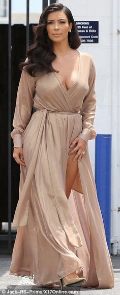 Feuding: Kim Kardashian (L) hit out at Adrienne Bailon for insulting her brother and their...